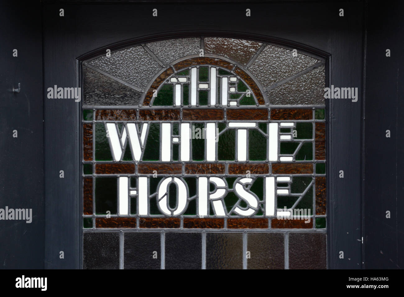 Stained glass window on the door of The White Horse at Neatishead, Norfolk Broads Stock Photo