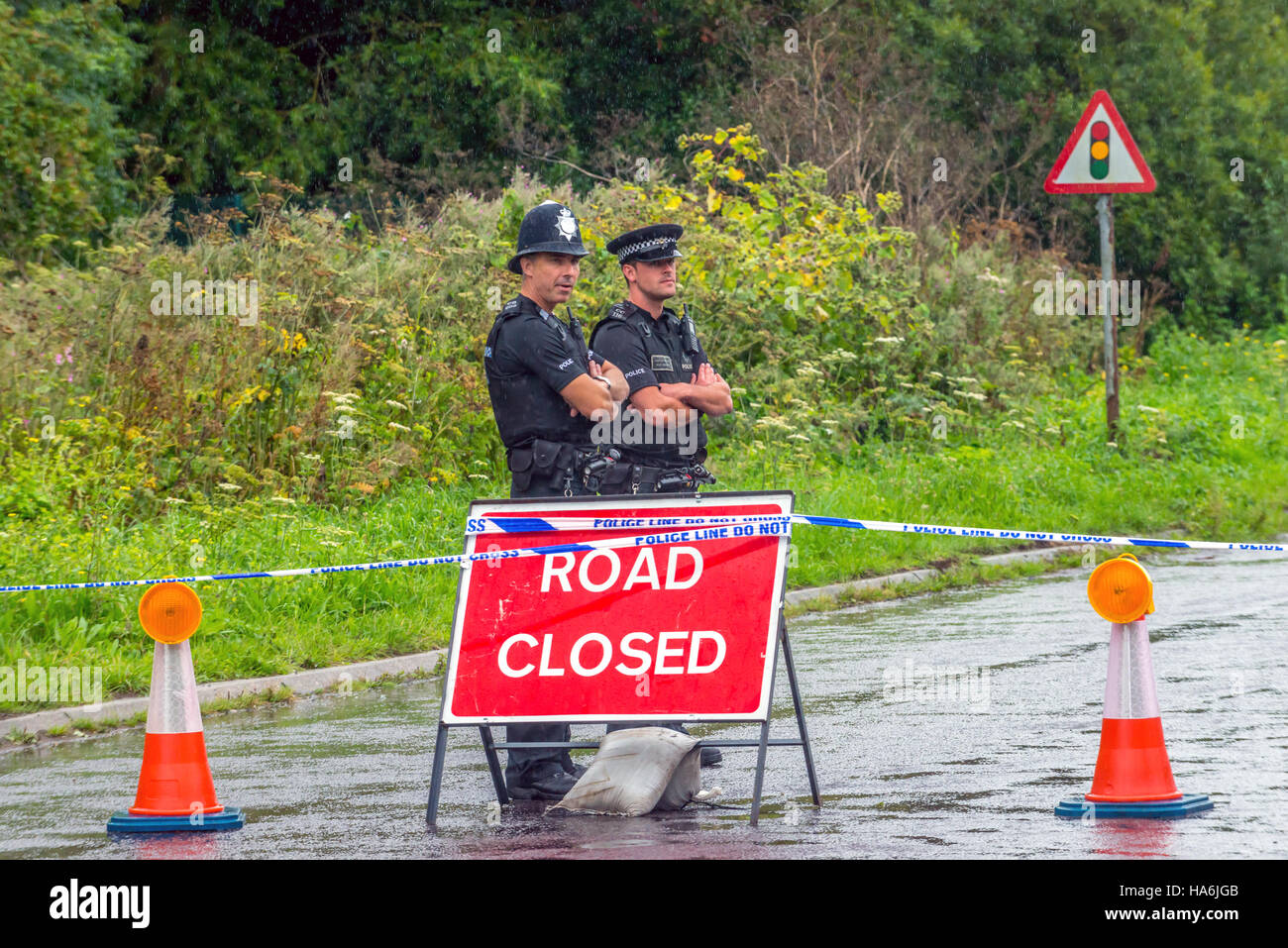 Police guard access to the A27 after the Shoreham air disaster - Stock Image