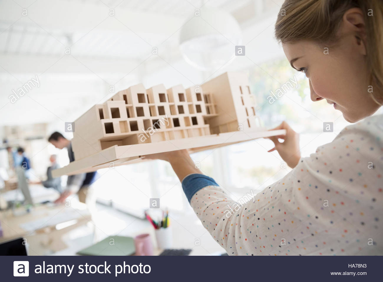 Female architect examining architectural model Stock Photo