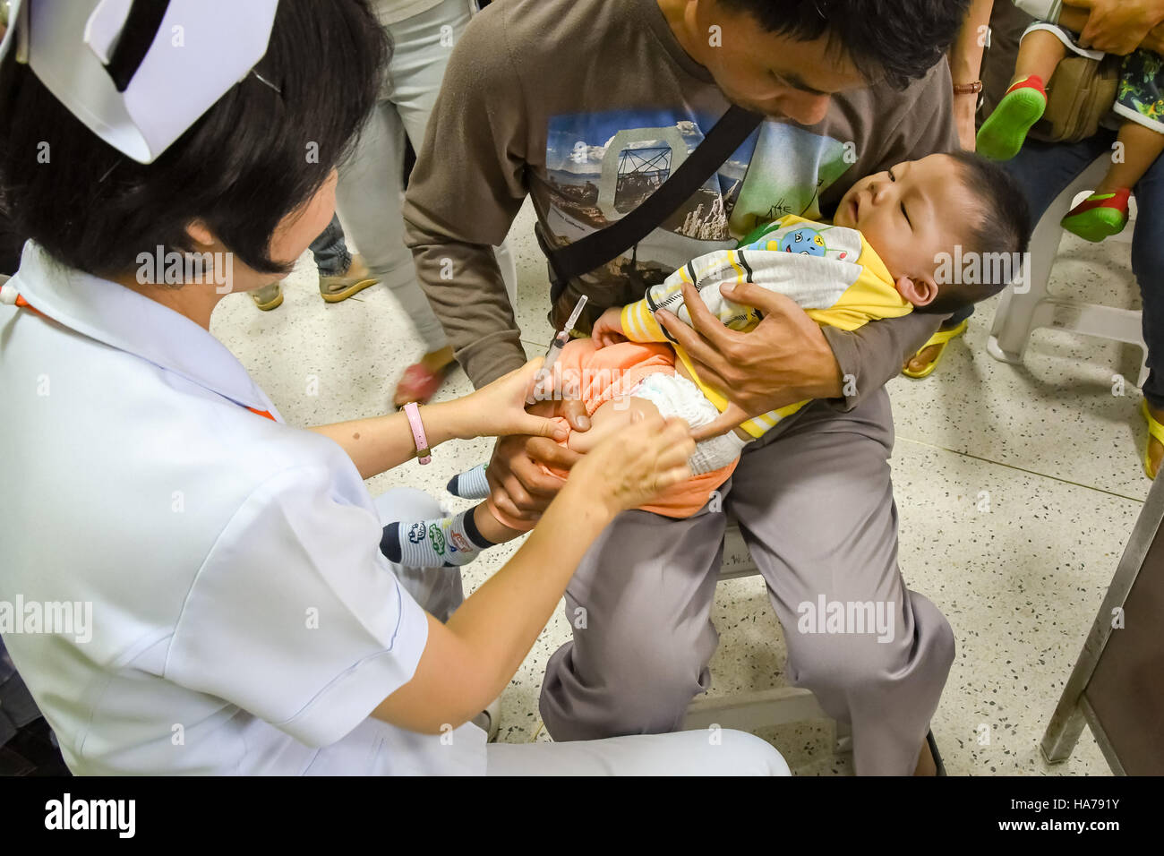 CHIANG MAI, Thailand - August 7, 2016:Children receiving vaccine at out side of the thigh.Children vaccine. CHIANG - Stock Image