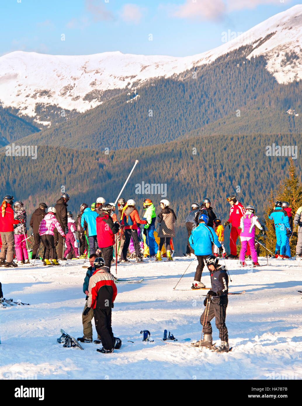 Lots of people at top of a slope in Bukovel. Bukovel is the most popular ski resort in Ukraine, in 2012 was named Stock Photo