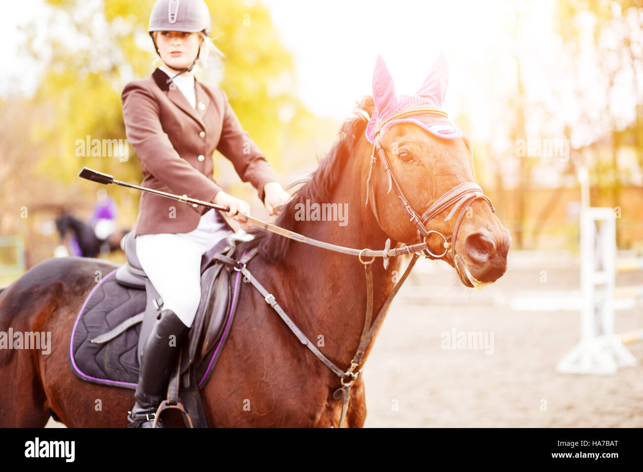 Young rider woman riding horse at the competition. Equestrian sport background - Stock Image