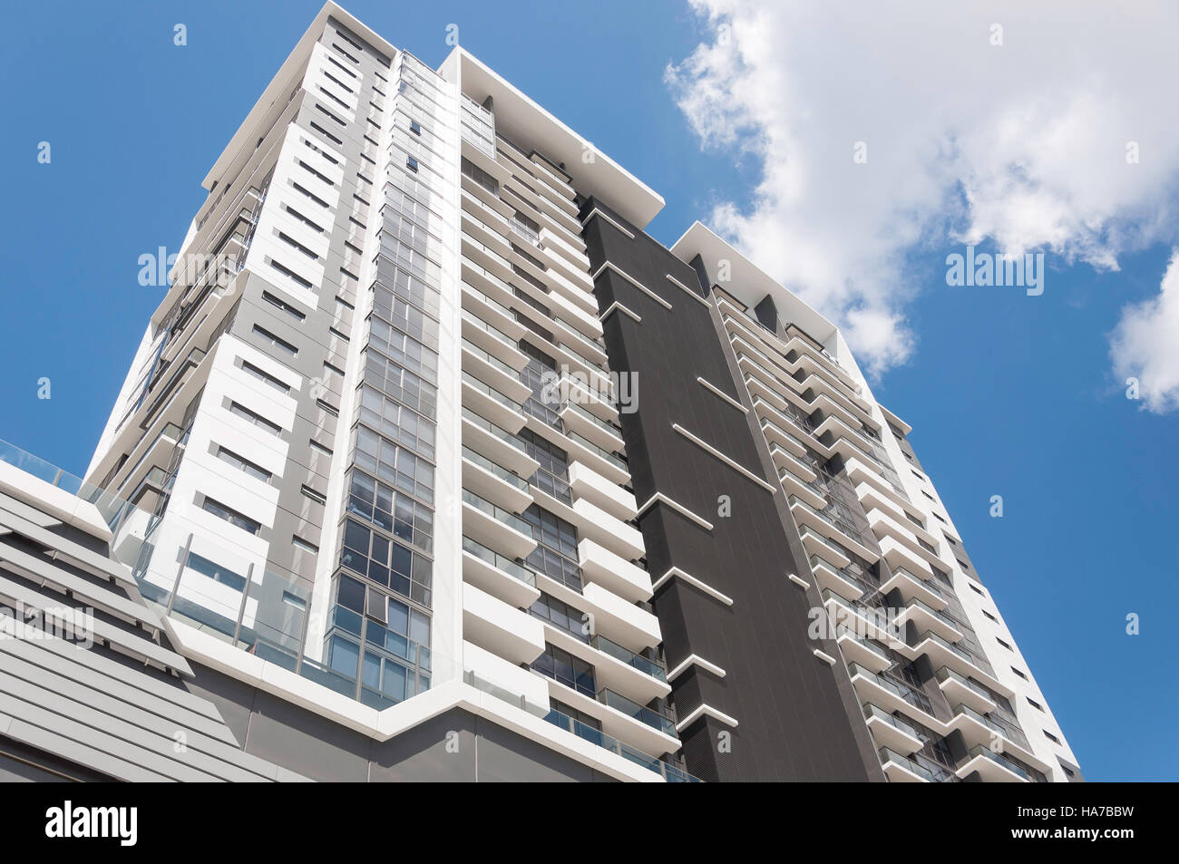 Modern apartment building overlooking Milton Railway Station, Milton, Brisbane, Queensland, Australia - Stock Image
