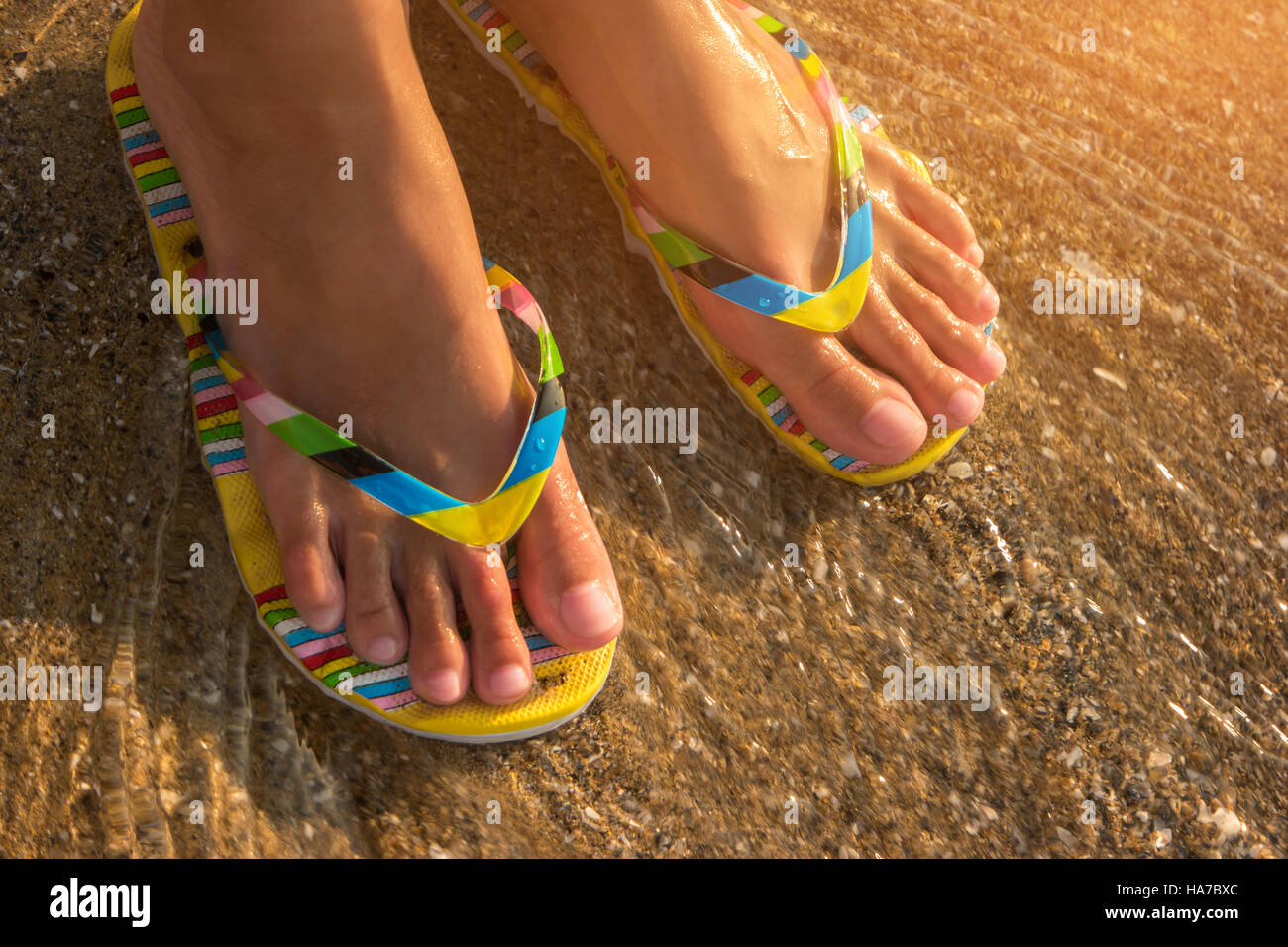 83fbda3ba48c40 Girl s feet in flip flops Stock Photo  126782164 - Alamy
