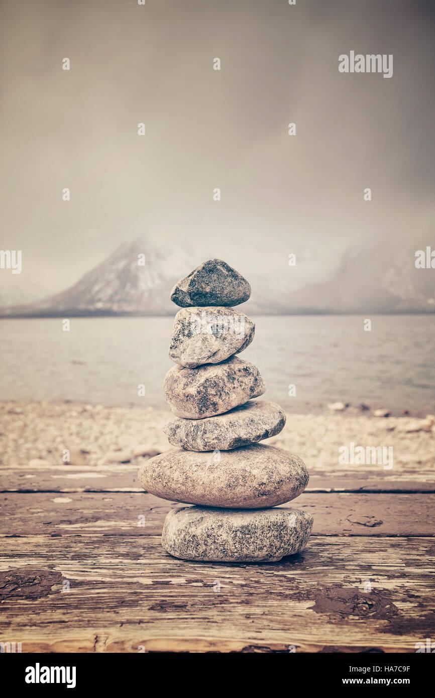 Vintage toned stack of stones, balance and harmony concept, Grand Teton National Park, Wyoming, USA. - Stock Image