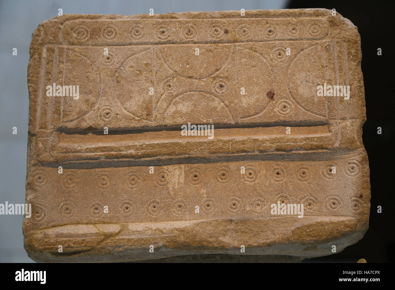 Iberians. Column with capital. Decorated with incised motifs (concentrics circles and double-headed axes). 2nd-1st - Stock Image