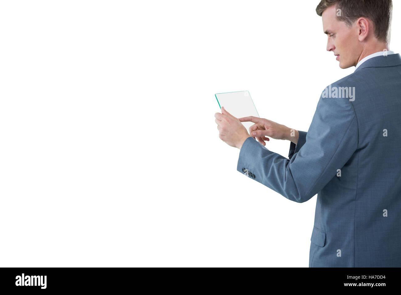 Businessman touching an glass sheet - Stock Image