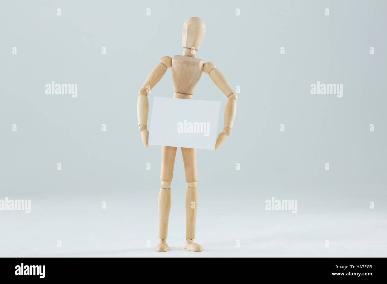 Wooden figurine holding blank placard - Stock Image