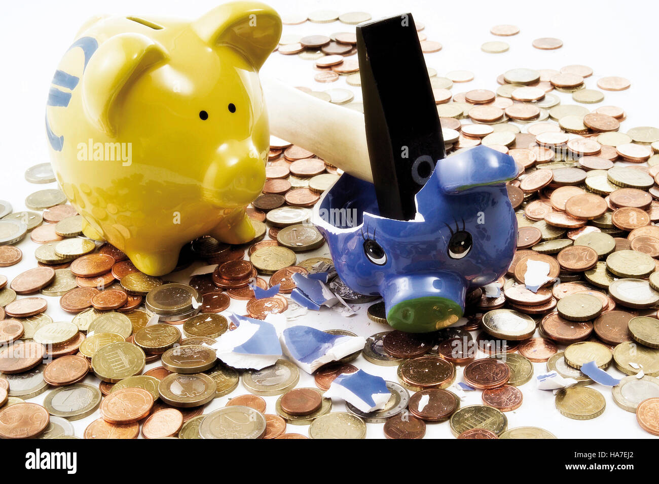 Piggy bank smashed by a hammer Stock Photo