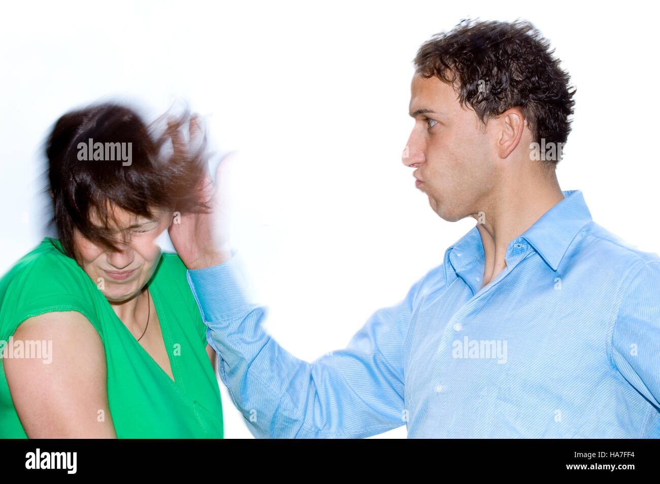Young man slapping a woman, posed scene - Stock Image