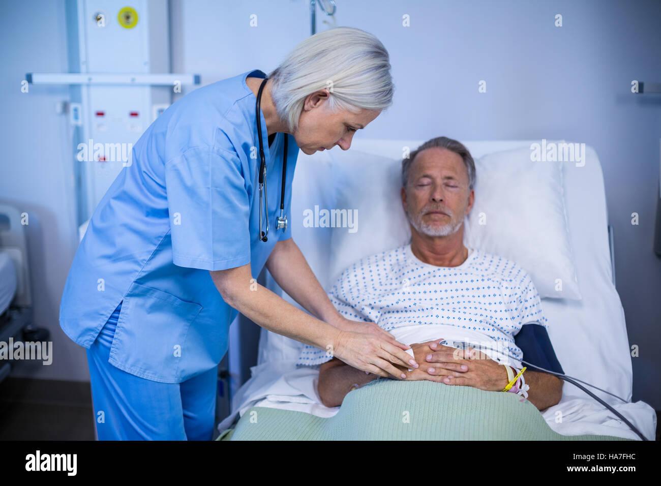 Nurse examining a patient - Stock Image
