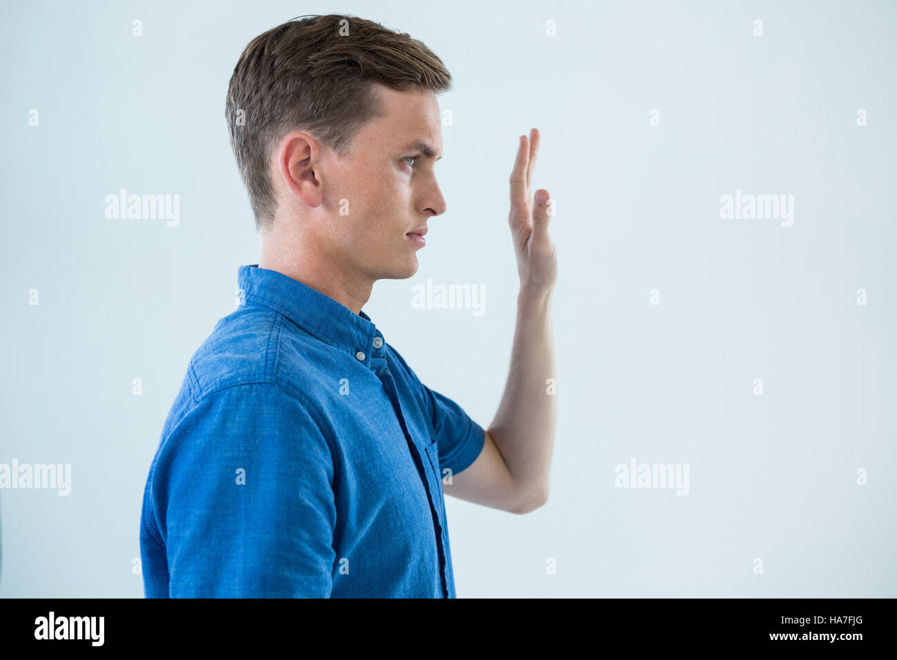 Man touching an invisible screen - Stock Image