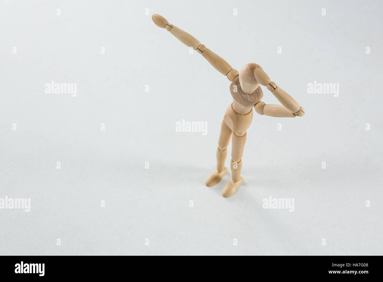 Wooden figurine shocked and pointing - Stock Image