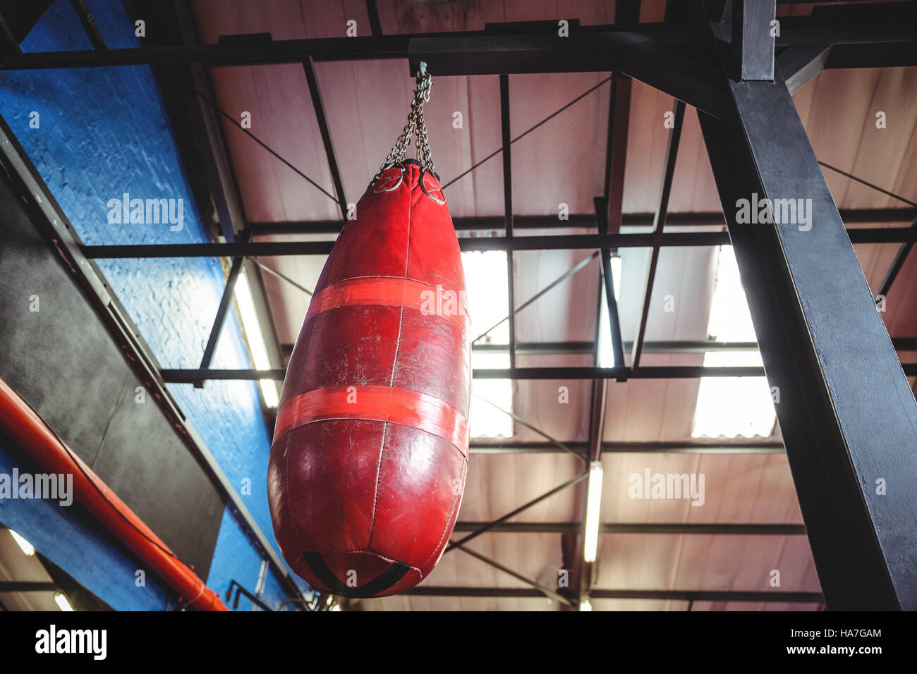 Punching bag hanging from ceiling - Stock Image