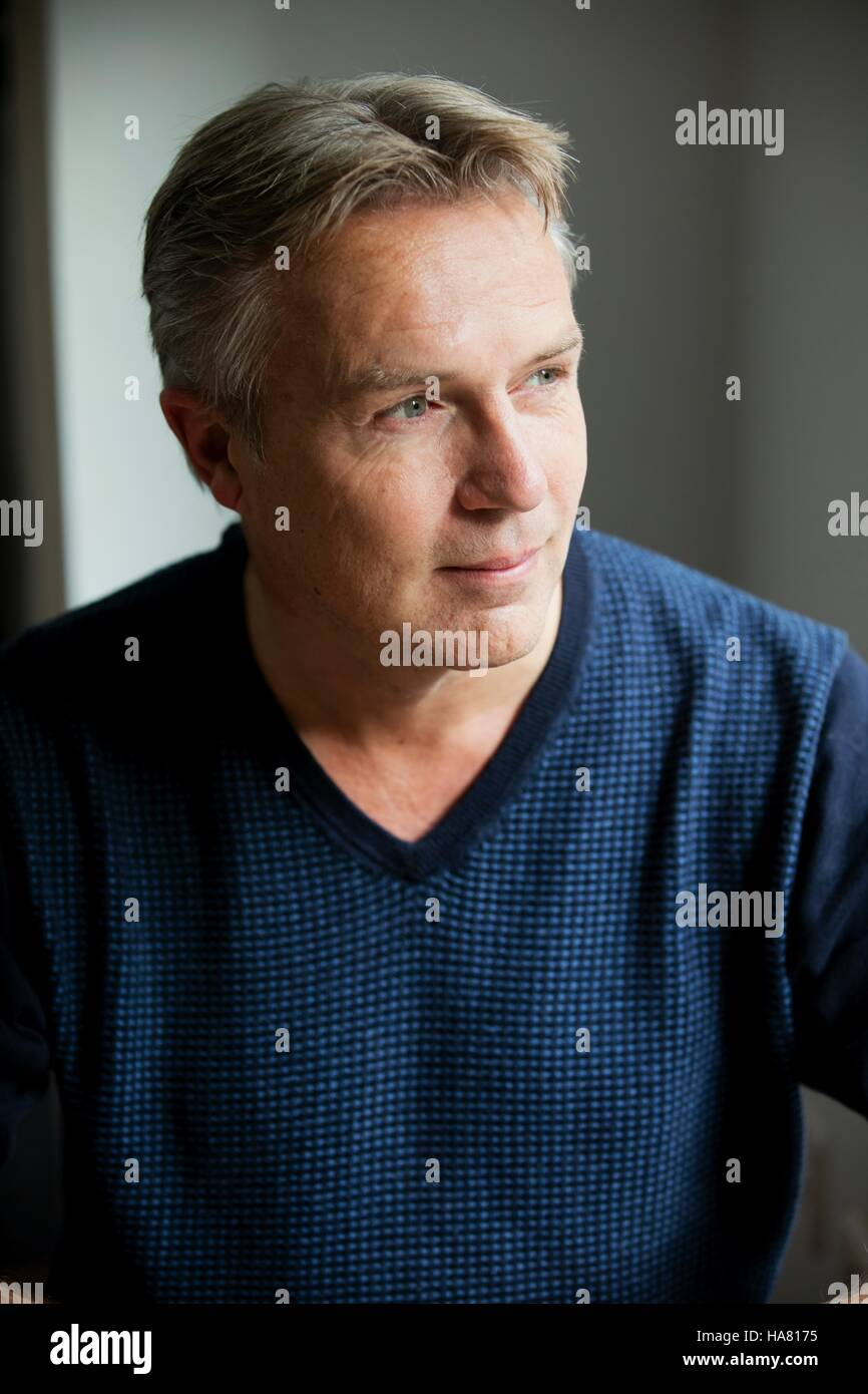 Adult man smiling and contemplate - Stock Image