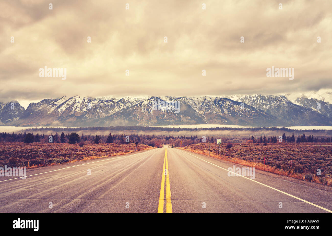 Vintage toned scenic road in the Grand Teton National Park, Wyoming, USA. - Stock Image