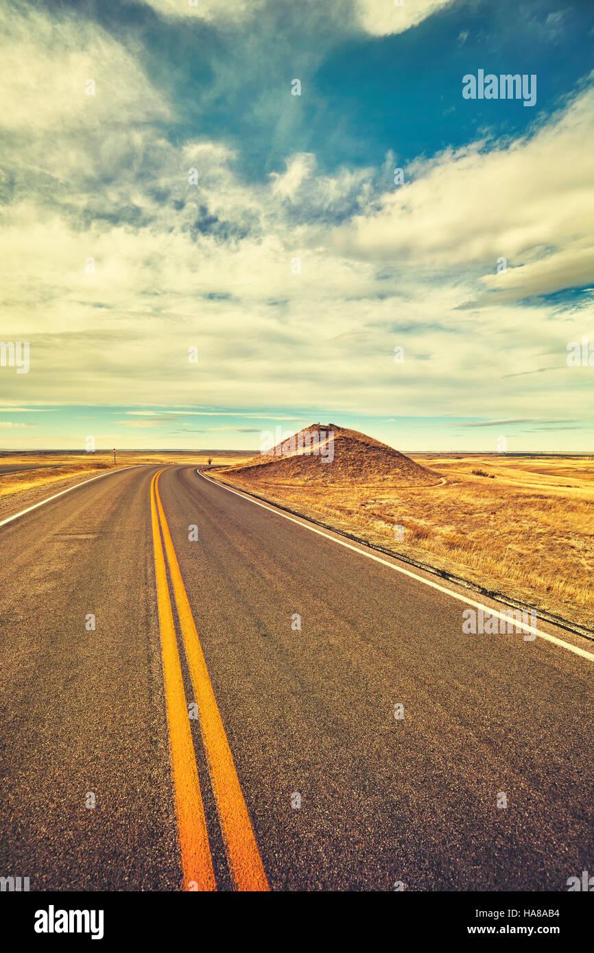Vintage toned desert road, travel concept, USA. - Stock Image