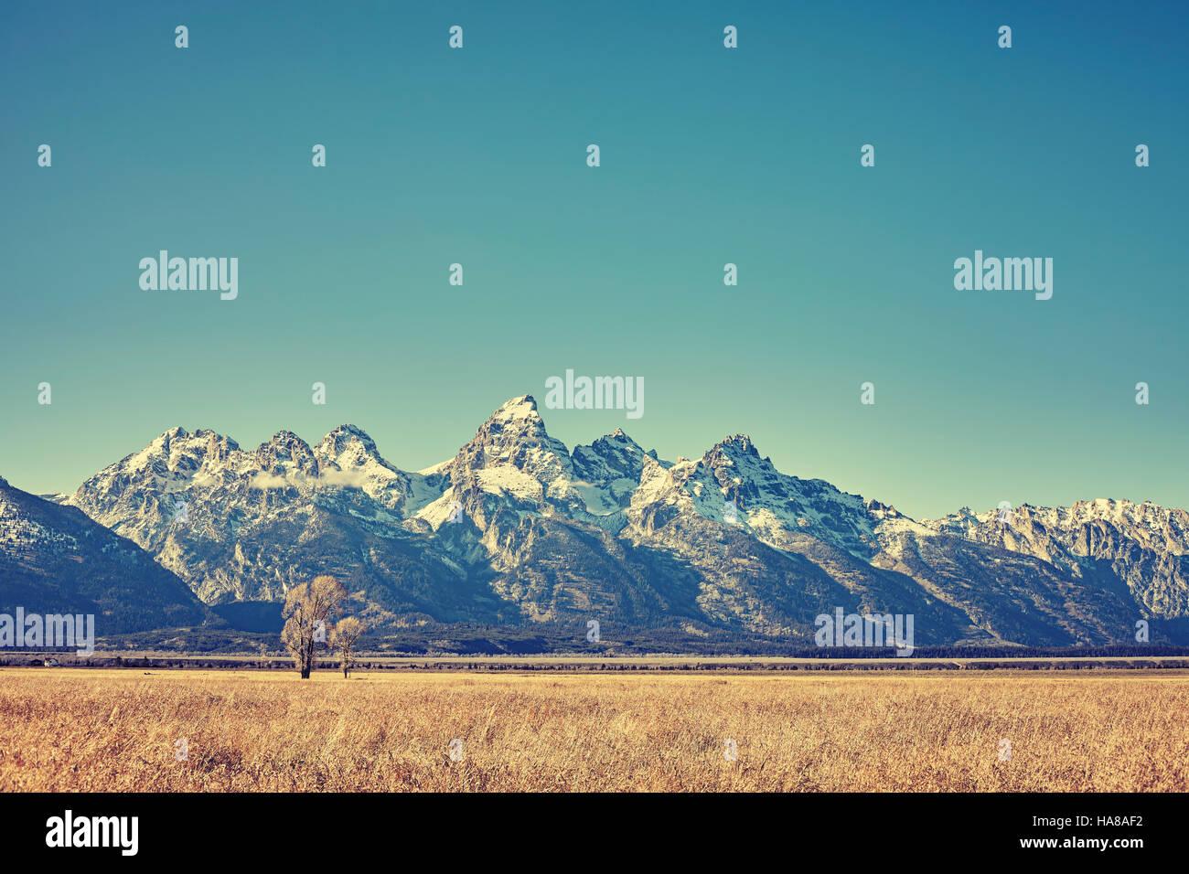 Retro toned view of Grand Teton mountain range, Wyoming, USA. - Stock Image