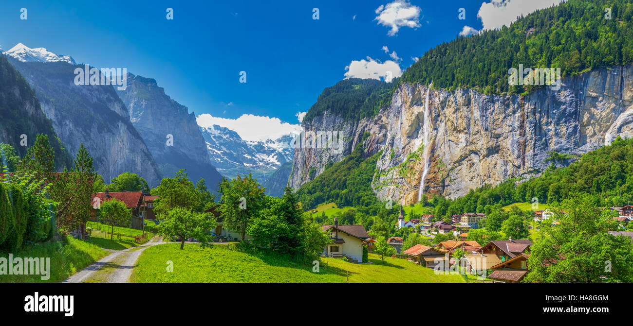 Famous Lauterbrunnen valley with gorgeous waterfall and Swiss Alps in the background, Berner Oberland, Switzerland, - Stock Image