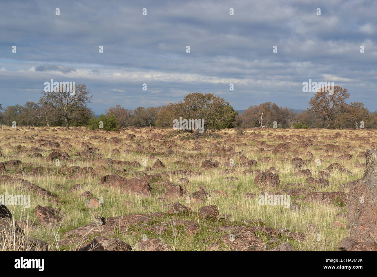Landscape of Red Bluff at the Sacramento River Bend area in the autumn, on a partly cloudy day - Stock Image