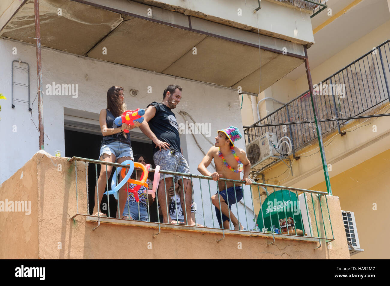 TEL-AVIV - JUNE 13, 2014: Spectator refresh the pride parade participants with cold water. The annual parade in - Stock Image