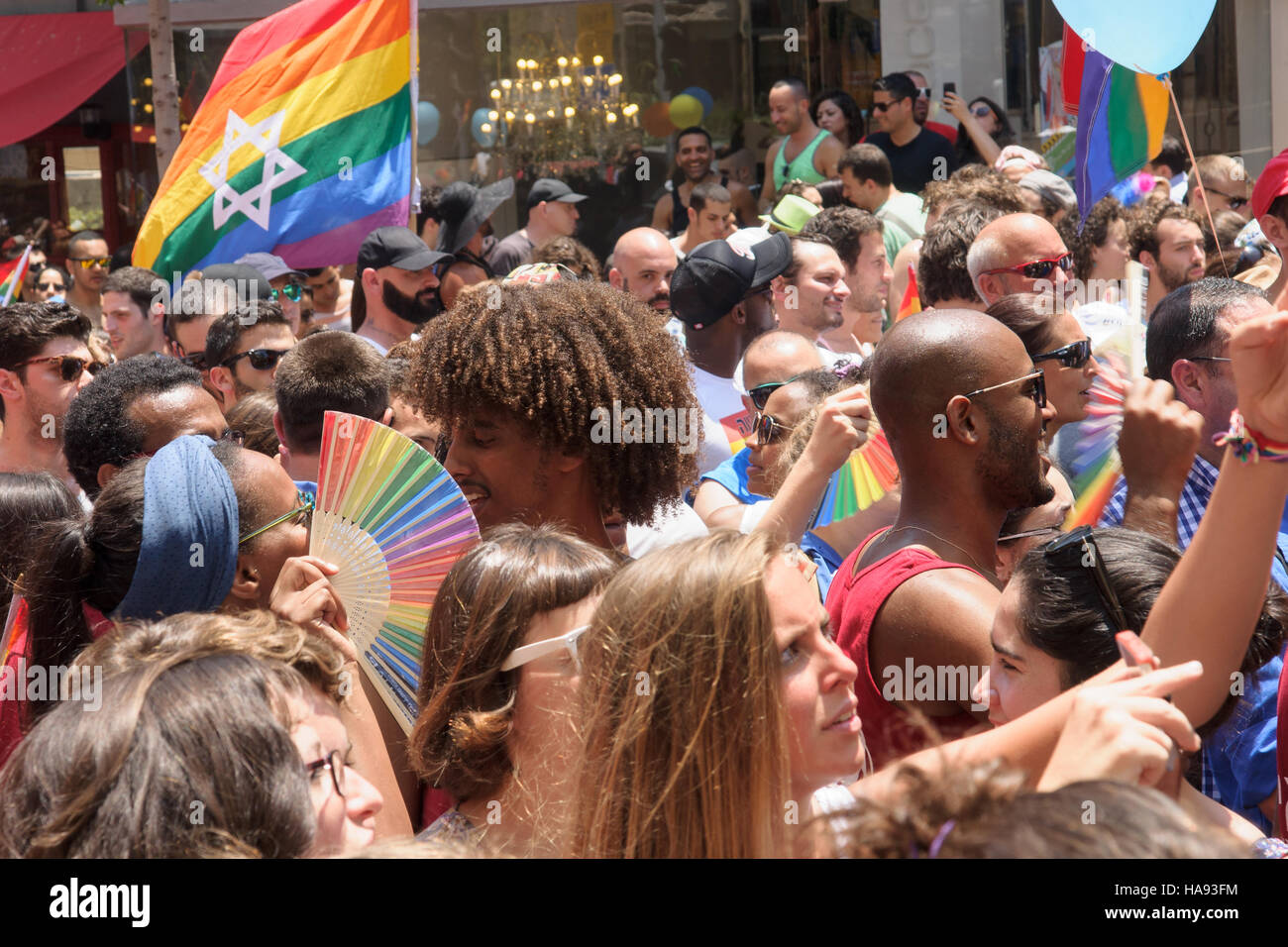 TEL-AVIV - JUNE 13, 2014: A crowd of people march in the Pride Parade in the streets of Tel-Aviv, Israel. The pride - Stock Image