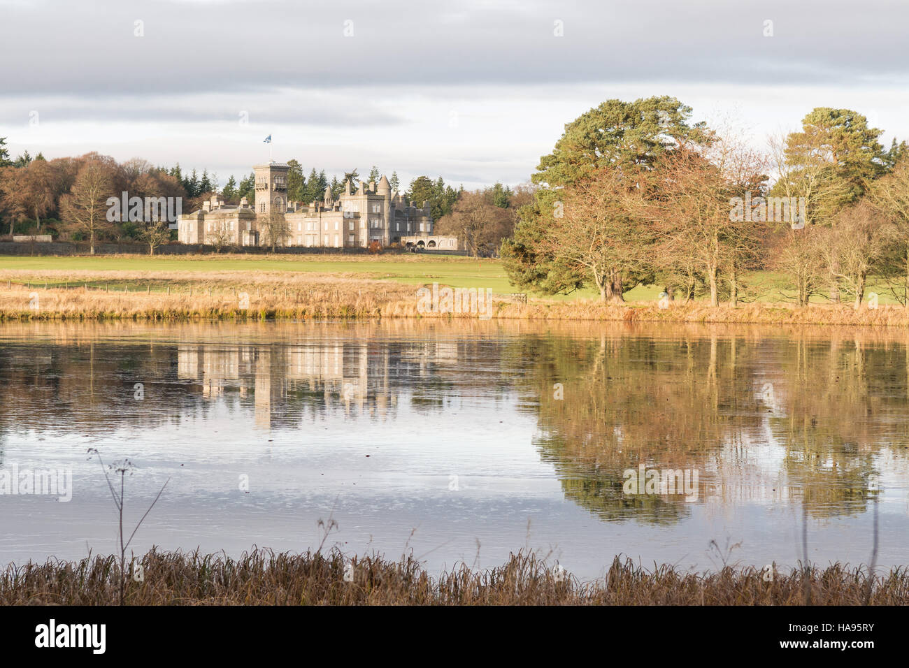 Dunecht House, Dunecht Estate, Aberdeenshire, Scotland, UK - reflections in the Policy Loch - Stock Image