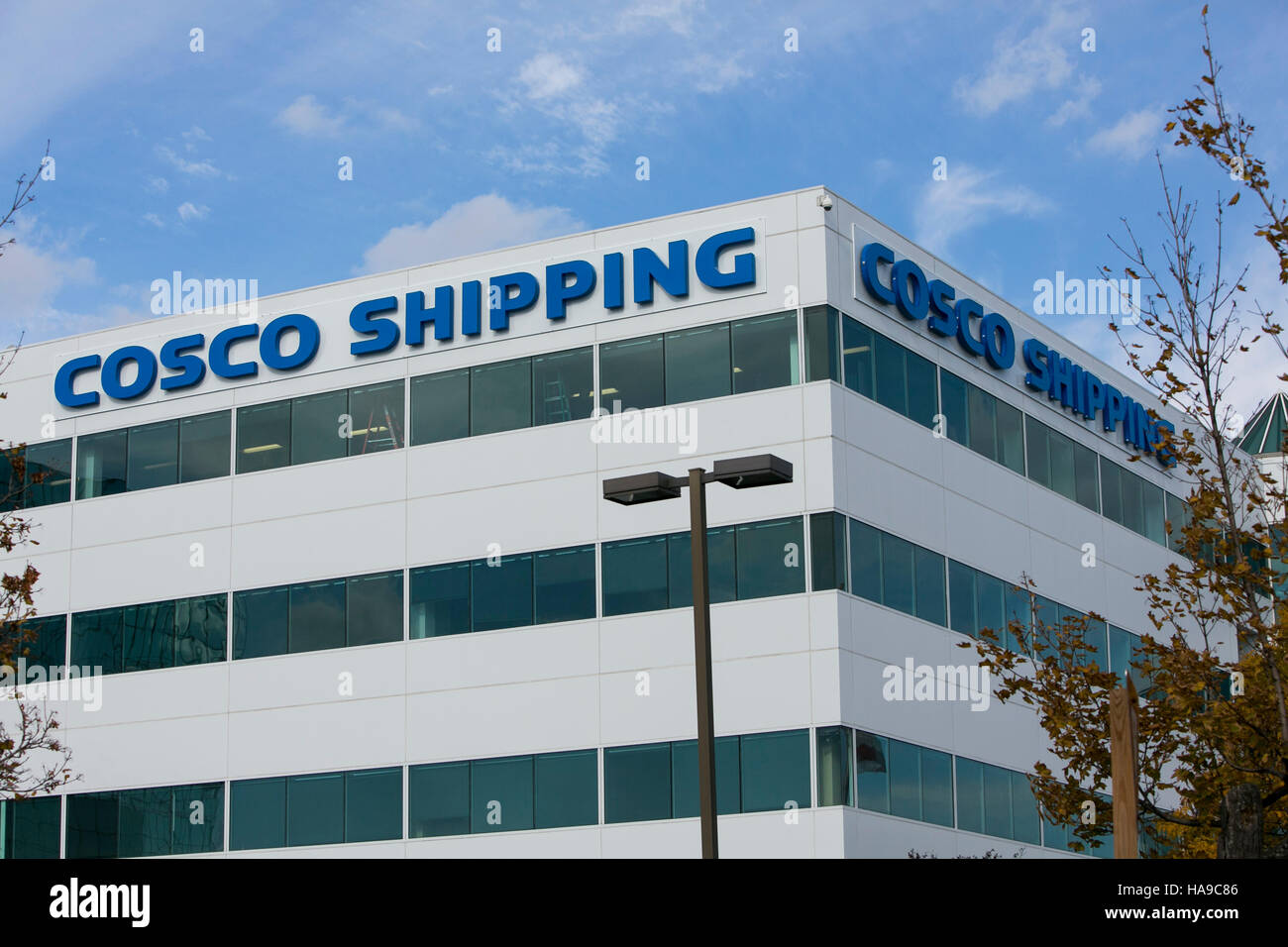 A logo sign outside of a facility occupied by the China Ocean Shipping Company (COSCO) in Secaucus, New Jersey on - Stock Image