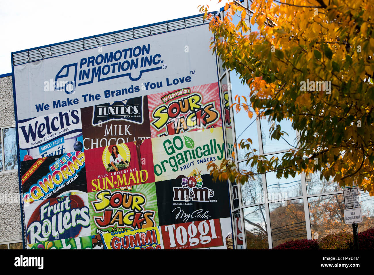 A logo sign outside of a facility occupied by The Promotion In Motion Companies, Inc., in Somerset, New Jersey on - Stock Image