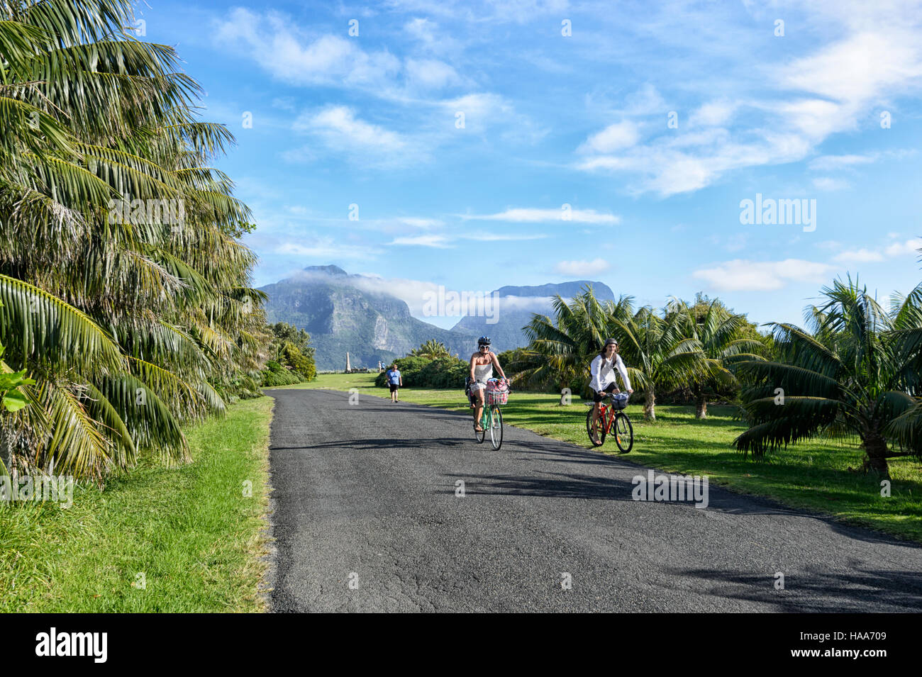 Persons cycling on Lord Howe Island, New South Wales, Australia - Stock Image
