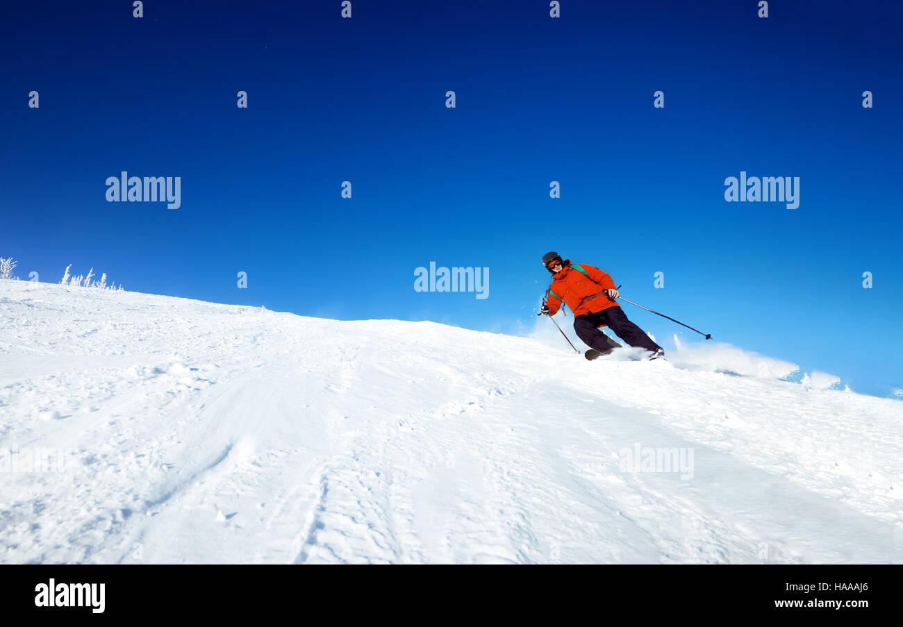 Skers rides slope skiing ski - Stock Image