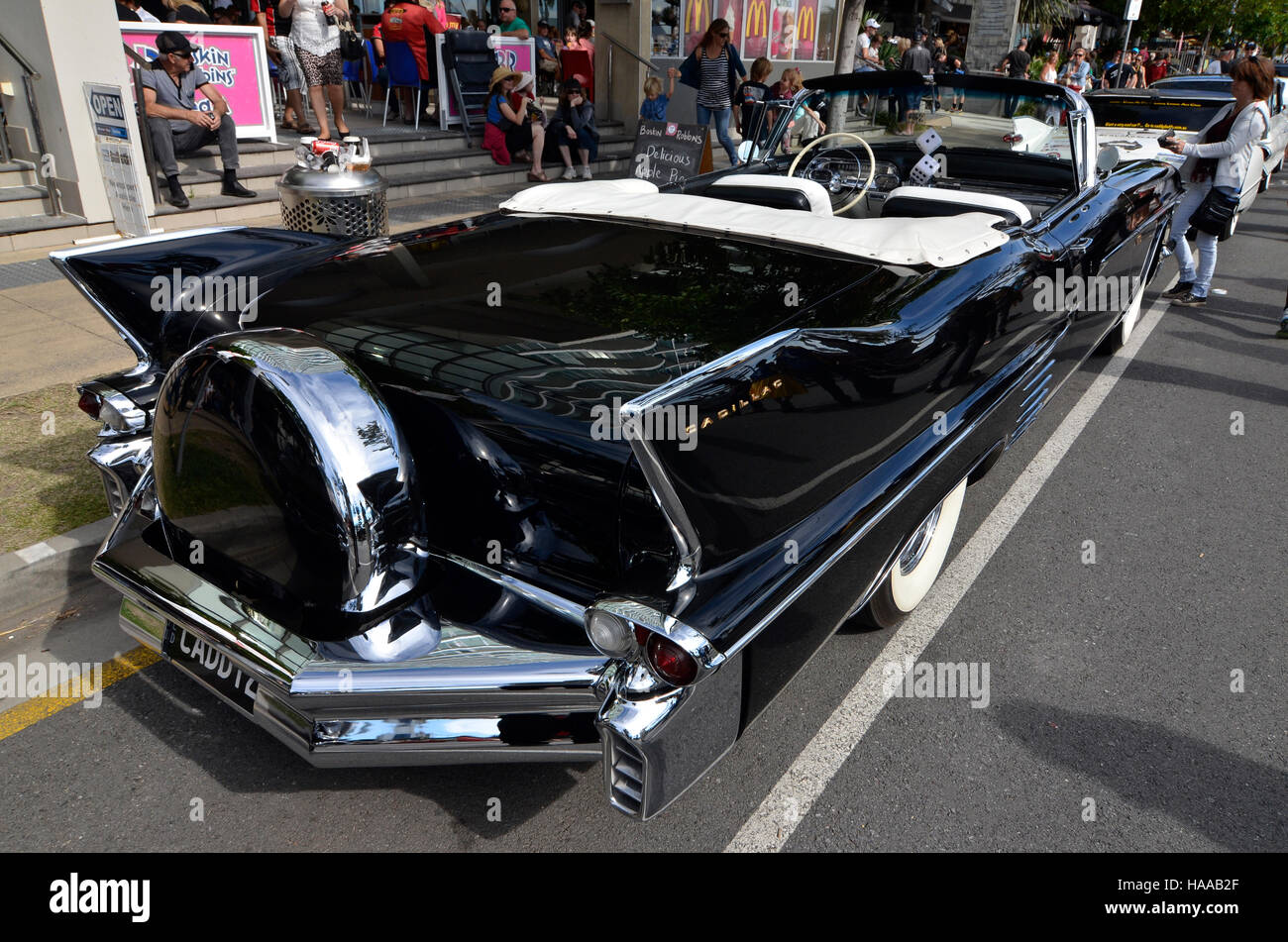 Customised black and chrome convertible soft top Caddilac at Cooly Rocks On retro festival at Coolangatta, gold - Stock Image