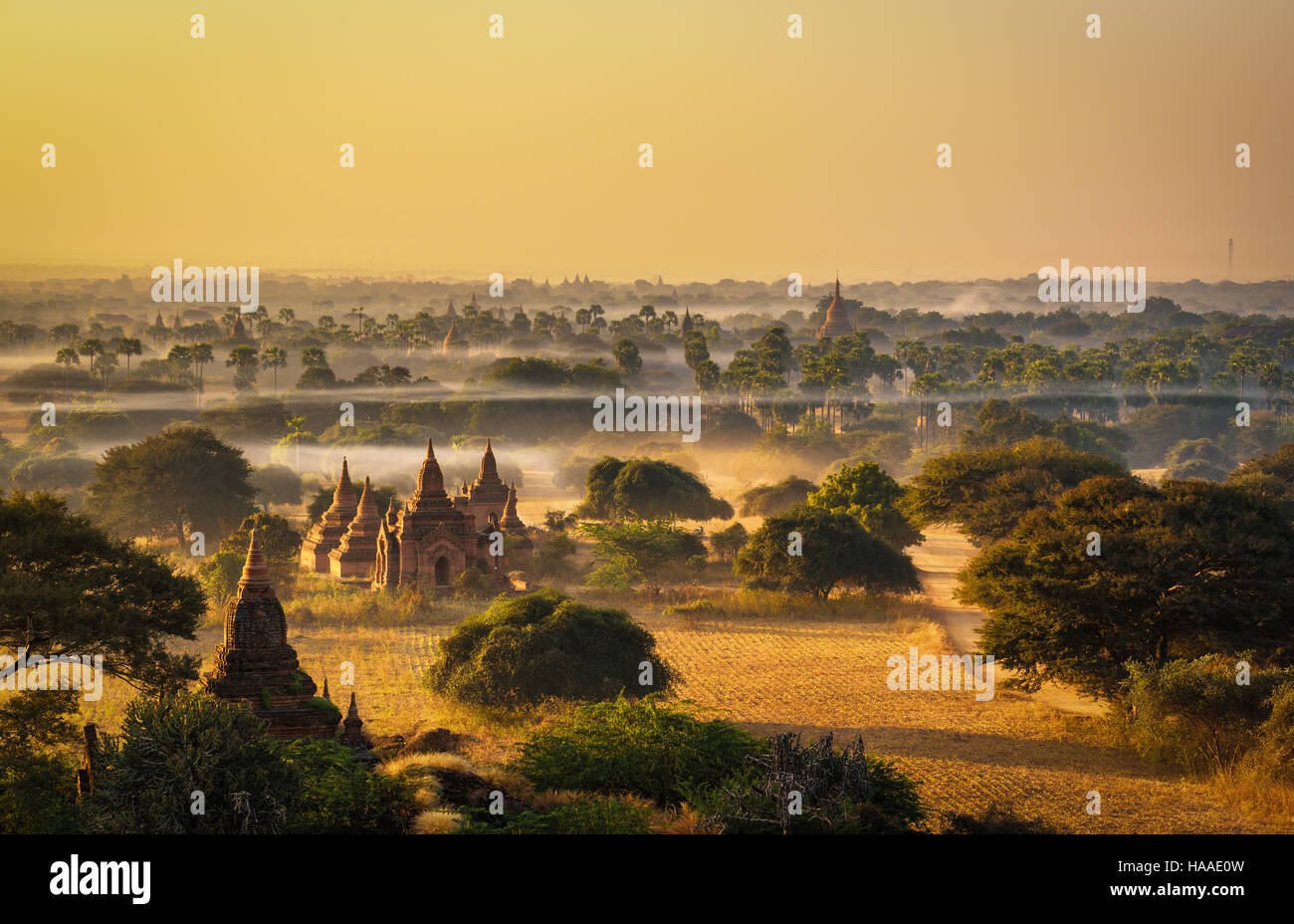 Sunrise above Bagan in Myanmar. Bagan is an ancient city with thousands of historic buddhist temples and stupas. - Stock Image