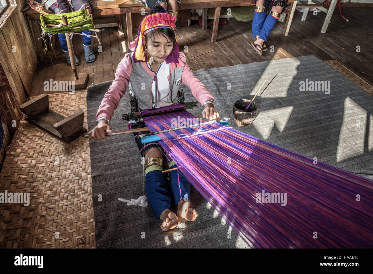 Woman of the Kayan Lahwi tribe weaves fabric Stock Photo