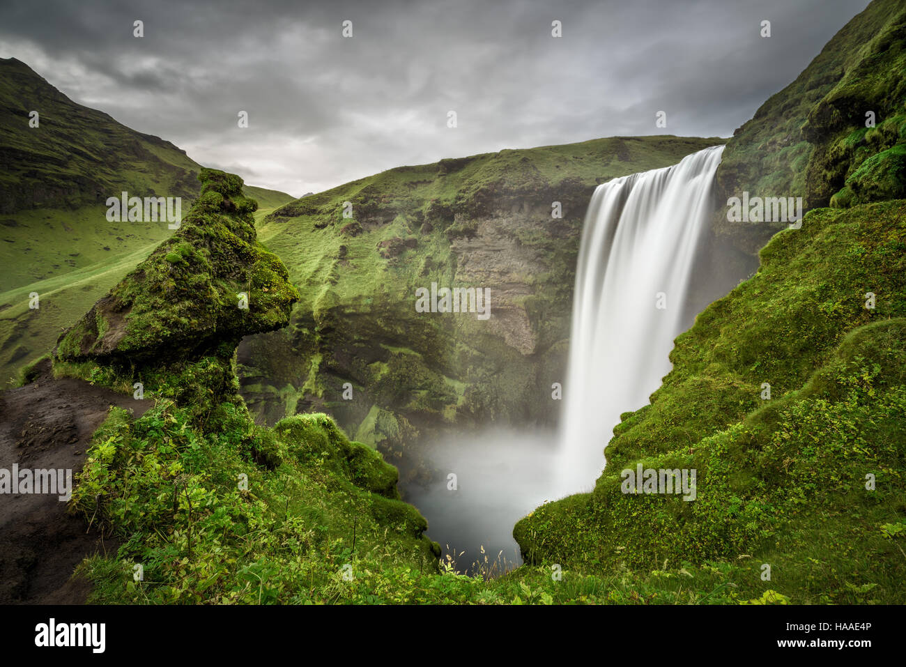 Skogafoss waterfall in southern Iceland viewed from above. Long exposure. - Stock Image