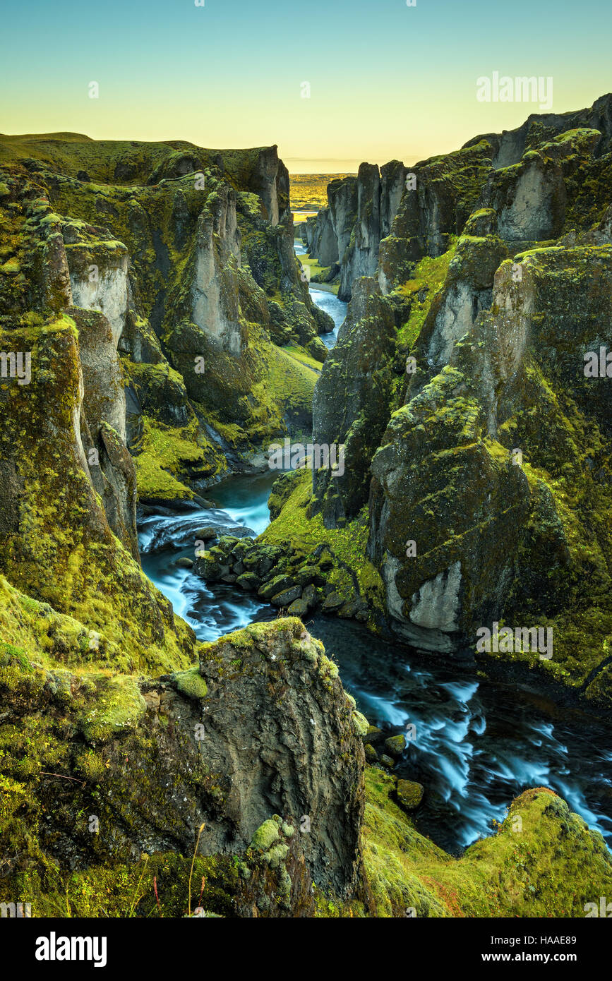 Deep Fjadrargljufur canyon and river flowing along the bottom of the canyon in south east Iceland. Long exposure. - Stock Image