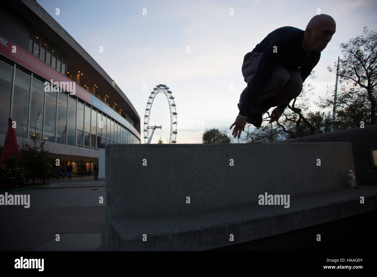 Parkour practitioners on the Southbank, London, United Kingdom. The South Bank is a significant arts and entertainment - Stock Image