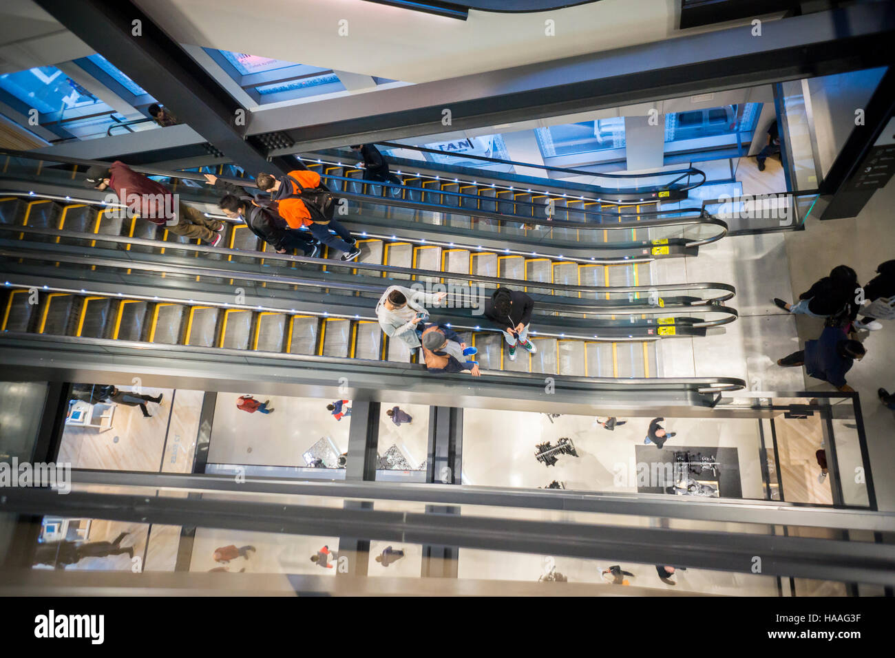 Customers crowd the new Nike flagship store on opening day in Soho in New  York on Friday, November 18, 2016. Nike is the largest global athletic shoe  and ...