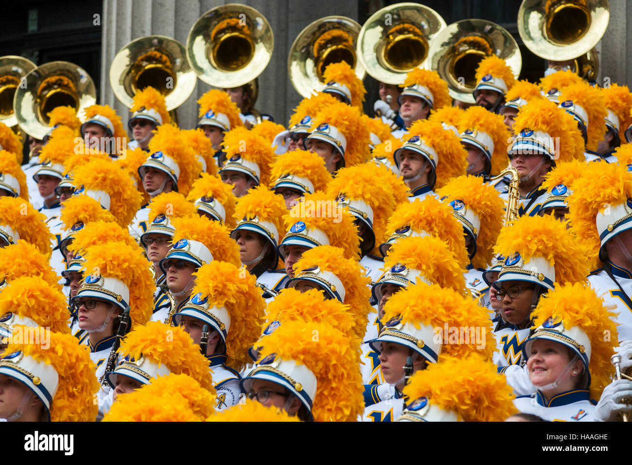 Members of the West Virginia University Mountaineer Marching Band pose for a group photograph after performing in - Stock Image
