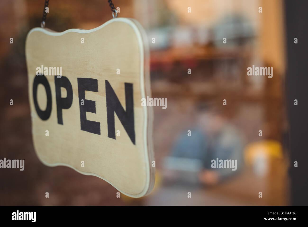 Open sign outside a café Stock Photo