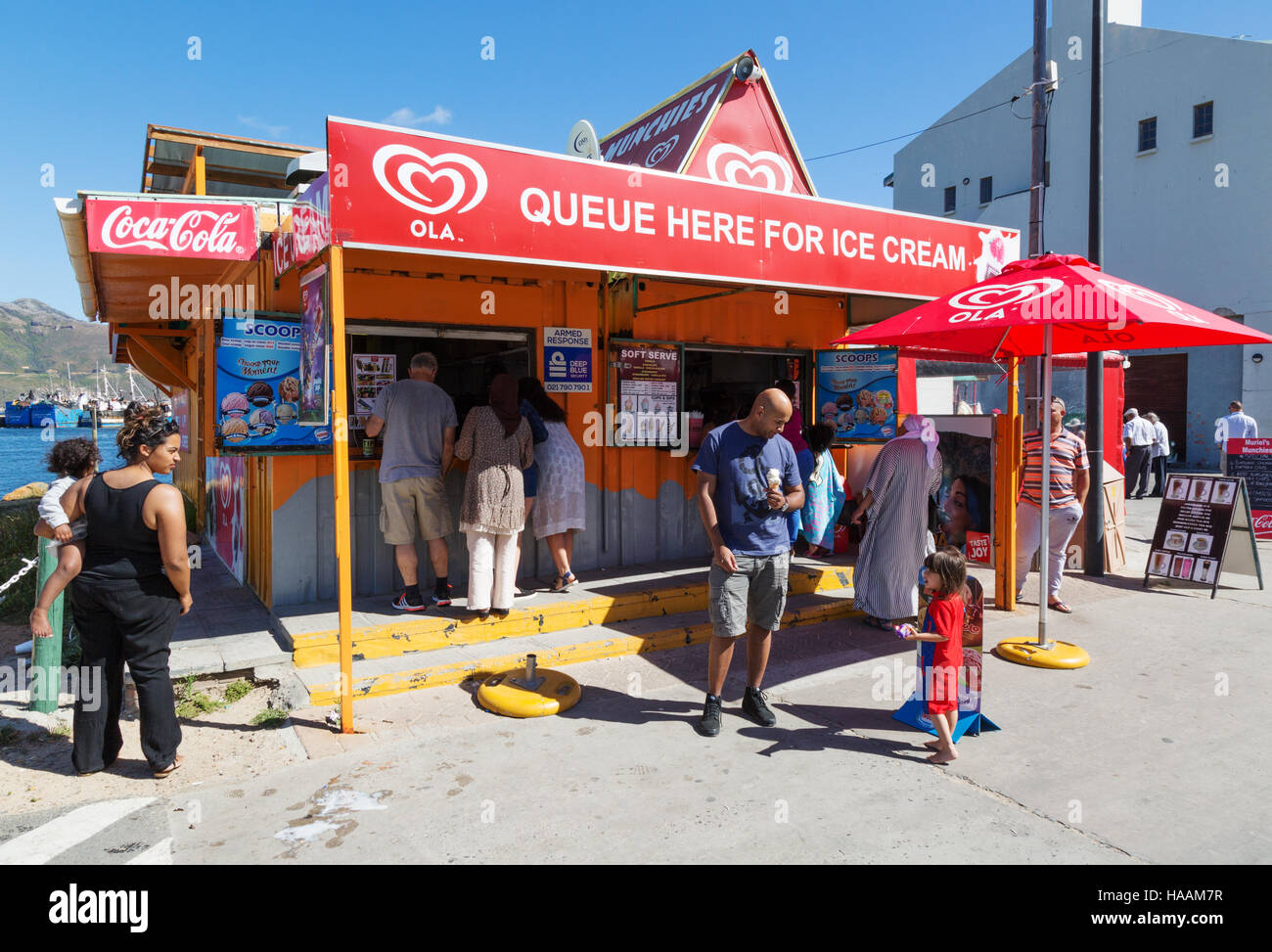 People buying ice cream at an ice cream shop, Hout Bay, Cape Peninsula, Cape Town, South Africa - Stock Image
