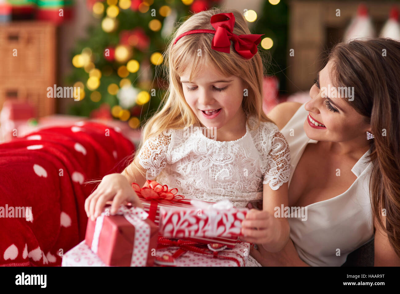 Mother bestowing daughter by plenty of presents - Stock Image