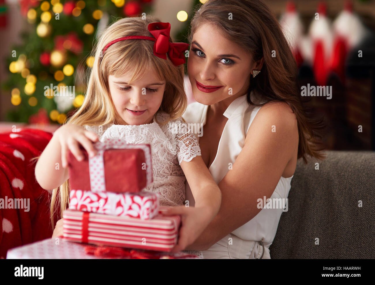 Little girl is bestowing by mother - Stock Image
