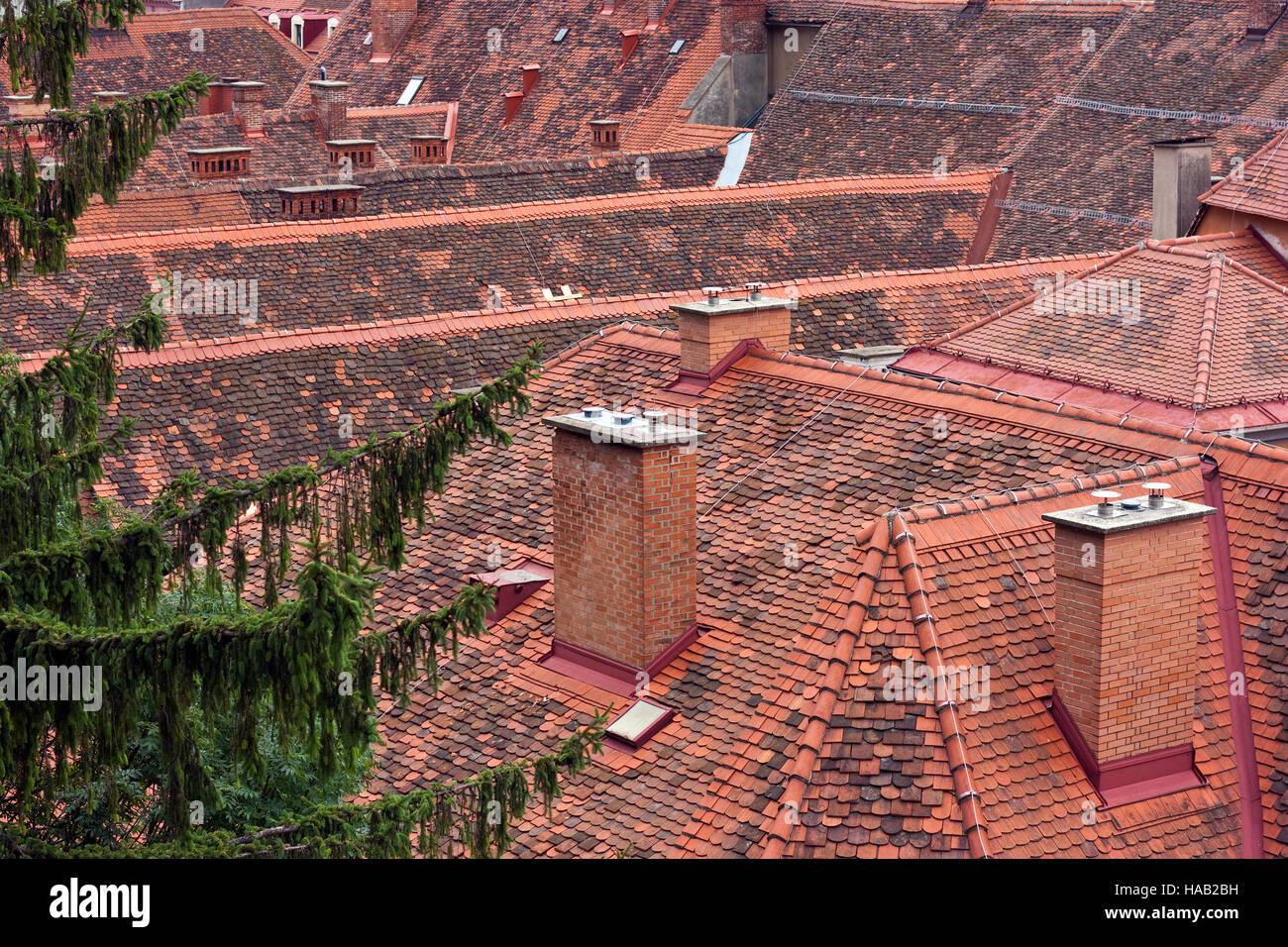 Inner city tiled roofs of Graz, Austria - Stock Image
