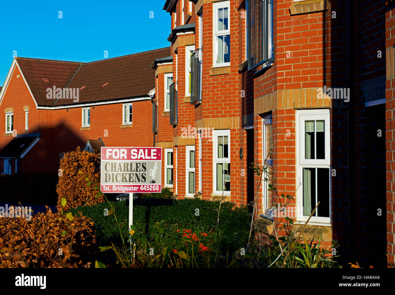 House for sale sign in Stockmoor Village, a new housing development near Bridgwater, Somerset, England UK - Stock Image