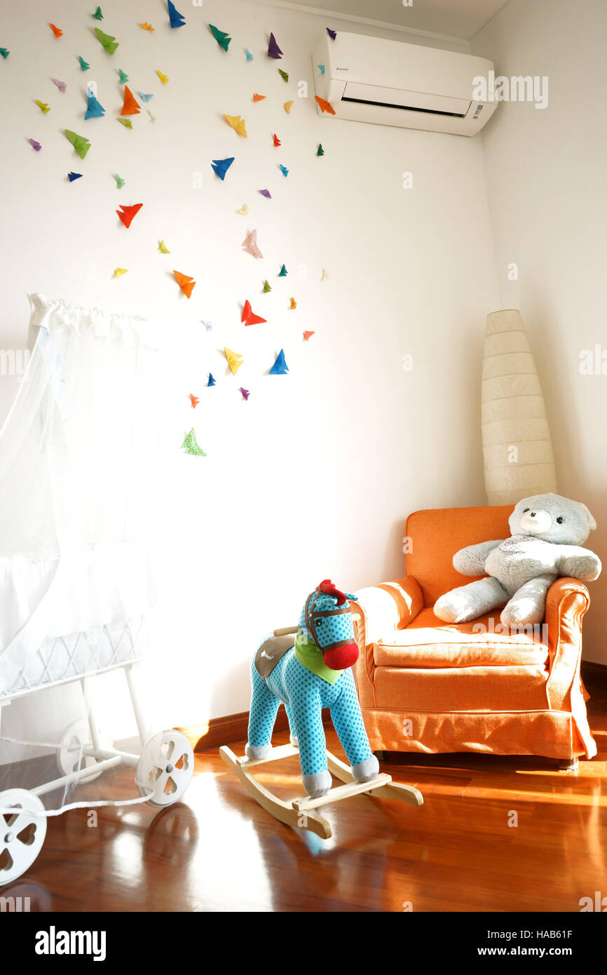Nursery room decor with butterfly origami - Stock Image