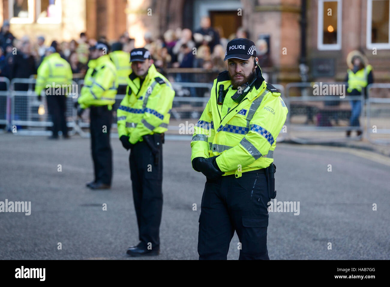 Chester, UK. 28th November 2016. A strong police presence outside Chester Cathedral as guests arrive for the memorial - Stock Image