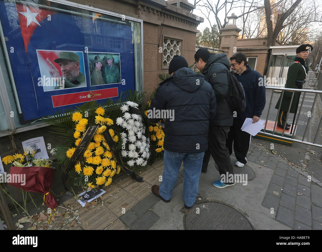 Beijing, CHINA, China. 27th Nov, 2016. Chinese government officials placed flowers with words encouraging 'anti - Stock Image