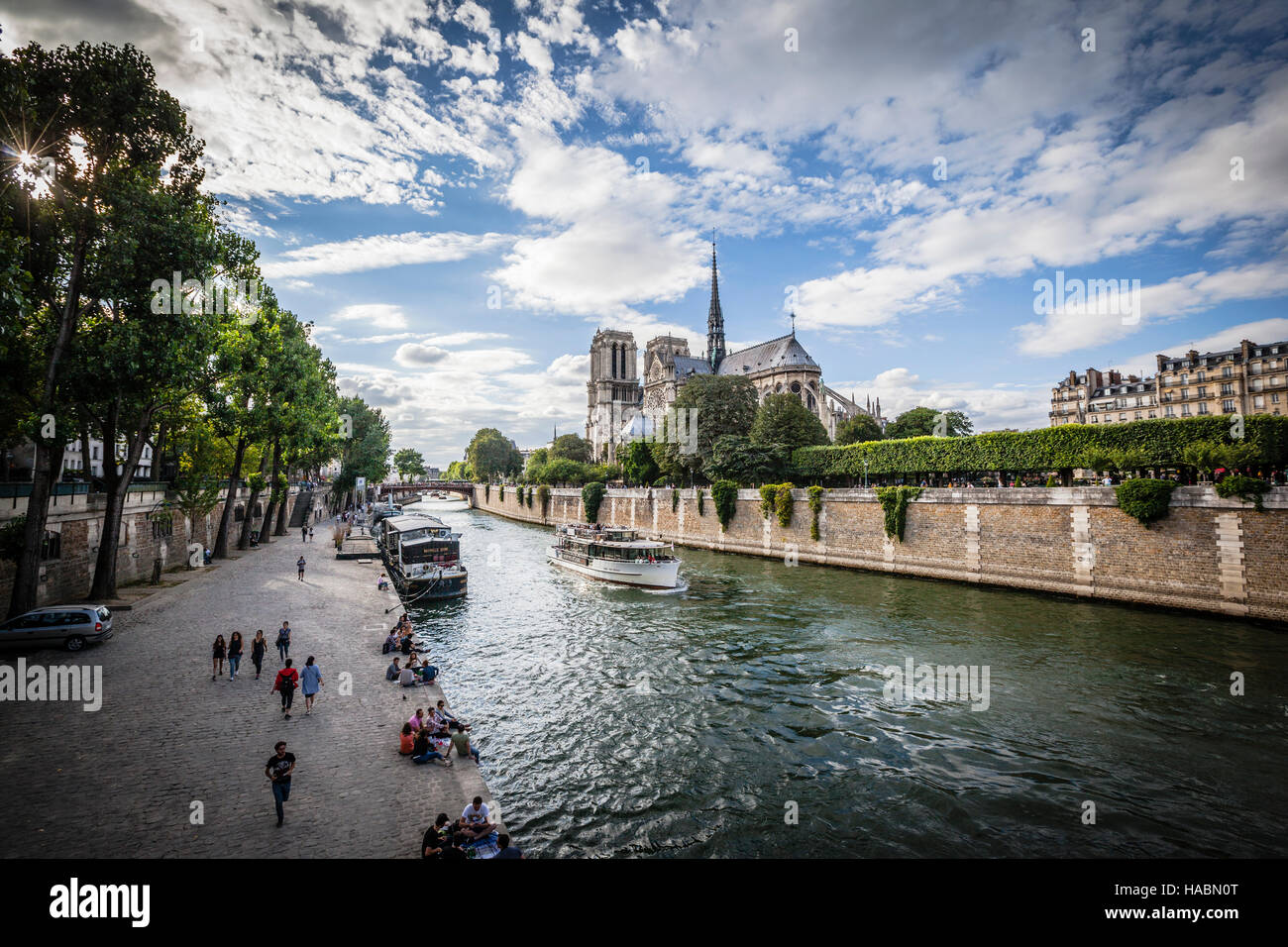 Notre Dame cathedral with puffy clouds, Paris, France - Stock Image