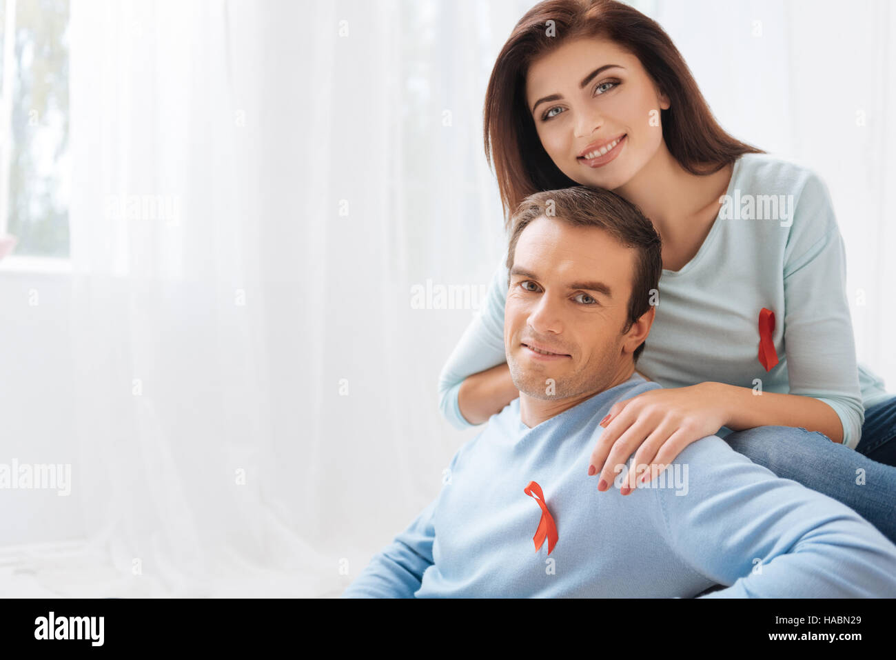 Pleasant optimistic couple showing their tolerance - Stock Image